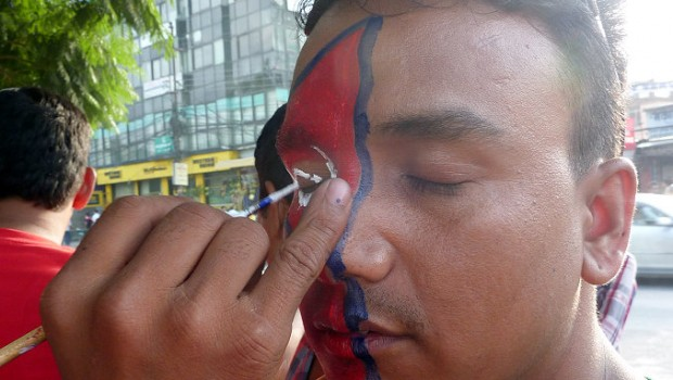 Dipak getting prepped for the game (100 rupees each for a facepaint ~ US$1