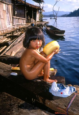 Bath time for a wee lass in a floating village in Thailand