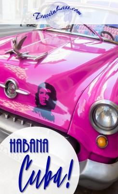 Havana, Cuba - cherry pink convertible with Che Guevara decal.