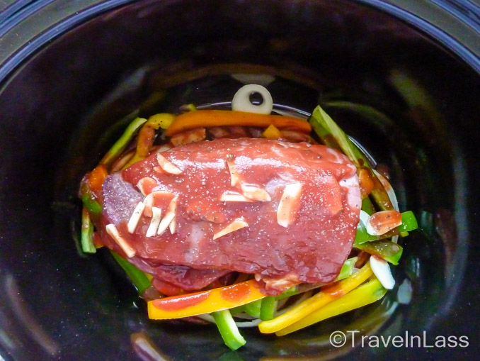Beef brisket ready to be tenderized in the slow cooker for Ropa Vieja