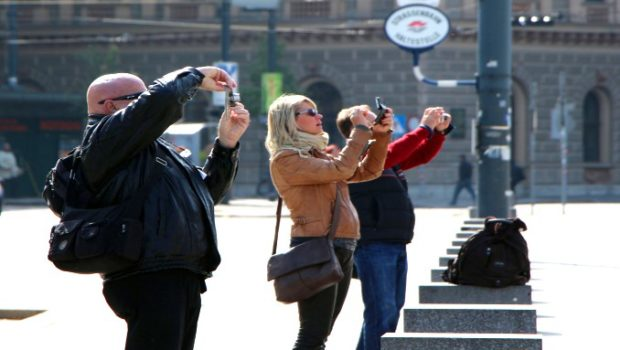 Tourists photographing the same thing.