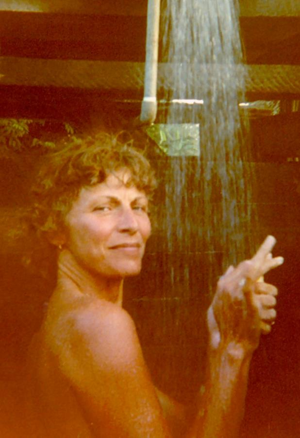 A much younger TravelnLass enjoying an outdoor shower amid the jungles of Belize.