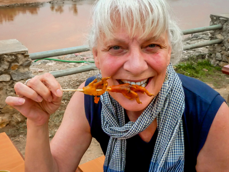 Eating Chicken Feet in Laos