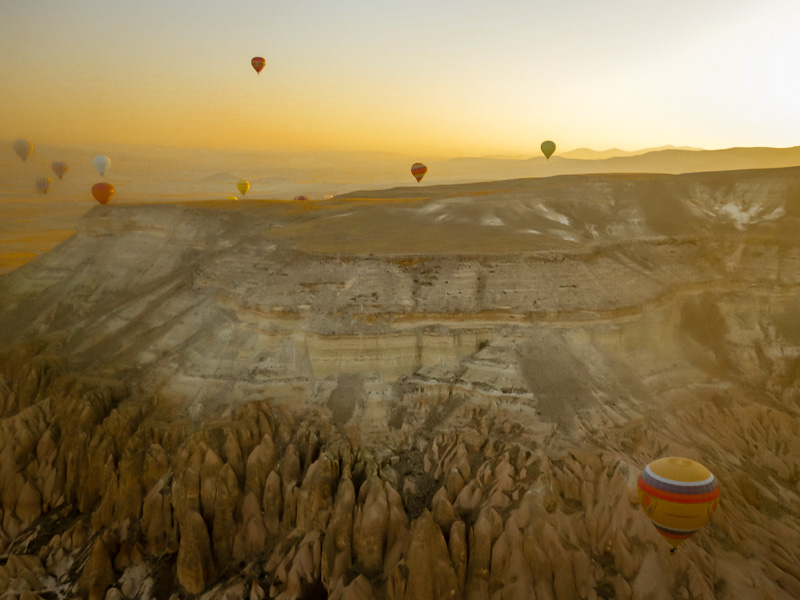 Ballooning above the fairy-tale landscape at dawn - Cappacodia, Turkey
